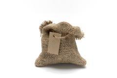 Saco vacío de la arpillera con la etiqueta Imágenes de archivo libres de regalías