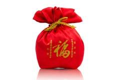 Saco vermelho, cumprimentando o ano novo em China imagens de stock