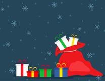 Saco vermelho do ` s de Santa com presentes Foto de Stock