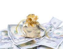 Saco y dólares del oro Imágenes de archivo libres de regalías