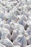 Sacos brancos enchidos com a areia Foto de Stock Royalty Free