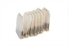 Sacos de chá no fundo isolado Imagens de Stock