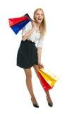 Sacos de compra carreg da mulher nova de Beautilful Foto de Stock Royalty Free
