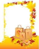 Sacos de compra com folhas amarelas Imagens de Stock