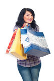 Sacos de compra felizes da terra arrendada da mulher Fotos de Stock