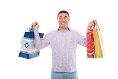 Sacos de compra felizes da terra arrendada do homem Foto de Stock Royalty Free