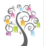 Sacos de compra na árvore Imagem de Stock Royalty Free