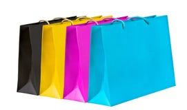 Sacos de compra pretos, amarelos, magentas, cianos. Imagem de Stock