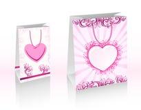 Sacos de compra roxos do vetor com corações ilustração royalty free
