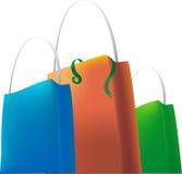 Sacos de compra verdes alaranjados azuis ilustração royalty free