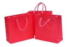 Sacos de compra vermelhos Imagens de Stock Royalty Free