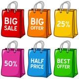 Sacos de compras coloridos dos desenhos animados ajustados Foto de Stock Royalty Free
