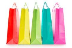 Sacos de compras coloridos no papel Fotos de Stock