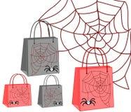 Sacos de compras com uma aranha e uma Web Foto de Stock Royalty Free