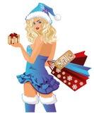 Sacos de compras da menina de Santa Fotos de Stock