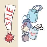 Sacos de compras e a bandeira da venda Imagem de Stock Royalty Free