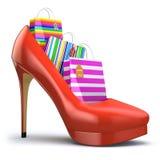 Sacos de compras em sapatas do salto alto das mulheres Conceito da consumição Foto de Stock Royalty Free