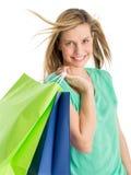 Sacos de compras levando da mulher bonita fotografia de stock royalty free