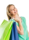 Sacos de compras levando da mulher feliz fotografia de stock royalty free