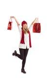 Sacos de compras levando louros bonitos Fotografia de Stock Royalty Free