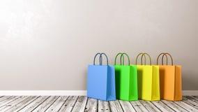 Sacos de compras no assoalho de madeira Foto de Stock Royalty Free
