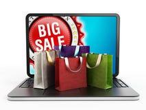 Sacos de compras no teclado de laptop Imagem de Stock