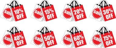 Sacos de compras varejos do disconto do vermelho Fotos de Stock Royalty Free
