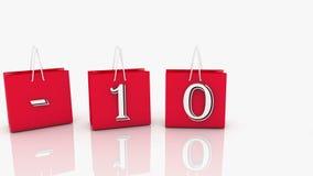 Sacos de compras vermelhos com inscrição de 10 por cento ilustração royalty free