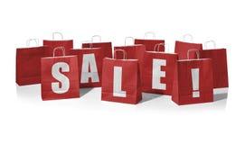 Sacos de compras vermelhos que formam a venda da palavra! Foto de Stock