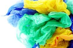 Sacos de lixo plásticos coloridos em um fundo branco Imagens de Stock Royalty Free