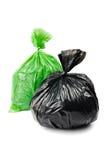 Sacos de lixo verdes e pretos Fotos de Stock Royalty Free