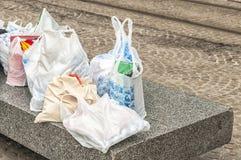Sacos de plástico diferentes colocados no concreto imagem de stock royalty free