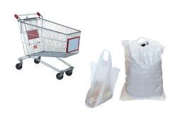 Sacos de plástico e o trole da compra Fotografia de Stock