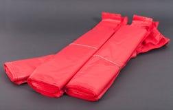 Sacos de plástico vermelhos Foto de Stock Royalty Free