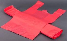 Sacos de plástico vermelhos Fotografia de Stock Royalty Free