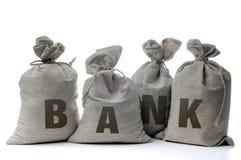 Sacos del dinero en un blanco Imagen de archivo