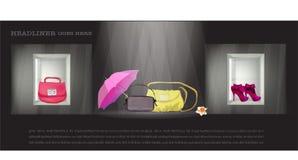 Sacos guarda-chuva e sapatas na janela da loja Imagens de Stock