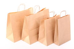 Sacos marrons de compra do presente isolados Fotografia de Stock