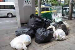 Sacos pretos Waste no assoalho em Banguecoque Imagem de Stock Royalty Free
