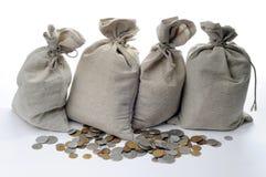 Sacos y monedas del dinero Imágenes de archivo libres de regalías