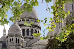 The Sacré Coeur in a green setting ( Montmarte Paris) Stock Photos