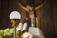 Sacrament of communion, Eucharist symbol. Eucharist symbol of bread and wine, chalice and host, First communion background stock image