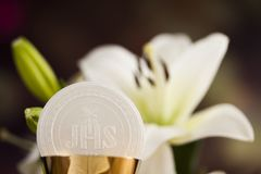 Holy communion a golden chalice with grapes and bread wafers. Sacrament of communion, Eucharist symbol royalty free stock photo