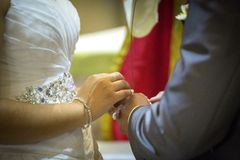 Sacrament of matrimony. Sacrament of marriage in the hands of the bride and groom Royalty Free Stock Photos