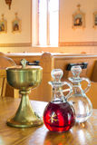 Sacramental / Communion wine and Holy water Stock Photos