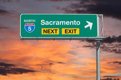 Sacramento Route 5 Next Exit Freeway Sign with Sunset Sky Stock Image