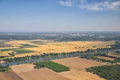 Sacramento downtown aerial from airplane, including view of rural surrounding farming and agricultural fields, river and landscape royalty free stock photo
