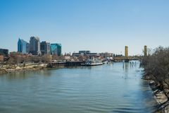 Afternoon view of Sacramento skyline with Sacramento River. Sacramento, FEB 21: Afternoon view of Sacramento skyline with Sacramento River on FEB 21, 2018 at royalty free stock photography