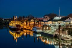 Night view of Sacramento skyline with Sacramento River. Sacramento, FEB 22: Night view of Sacramento skyline with Sacramento River on FEB 22, 2018 at Sacramento royalty free stock images