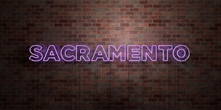 SACRAMENTO - fluorescent Neon tube Sign on brickwork - Front view - 3D rendered royalty free stock picture Stock Photography